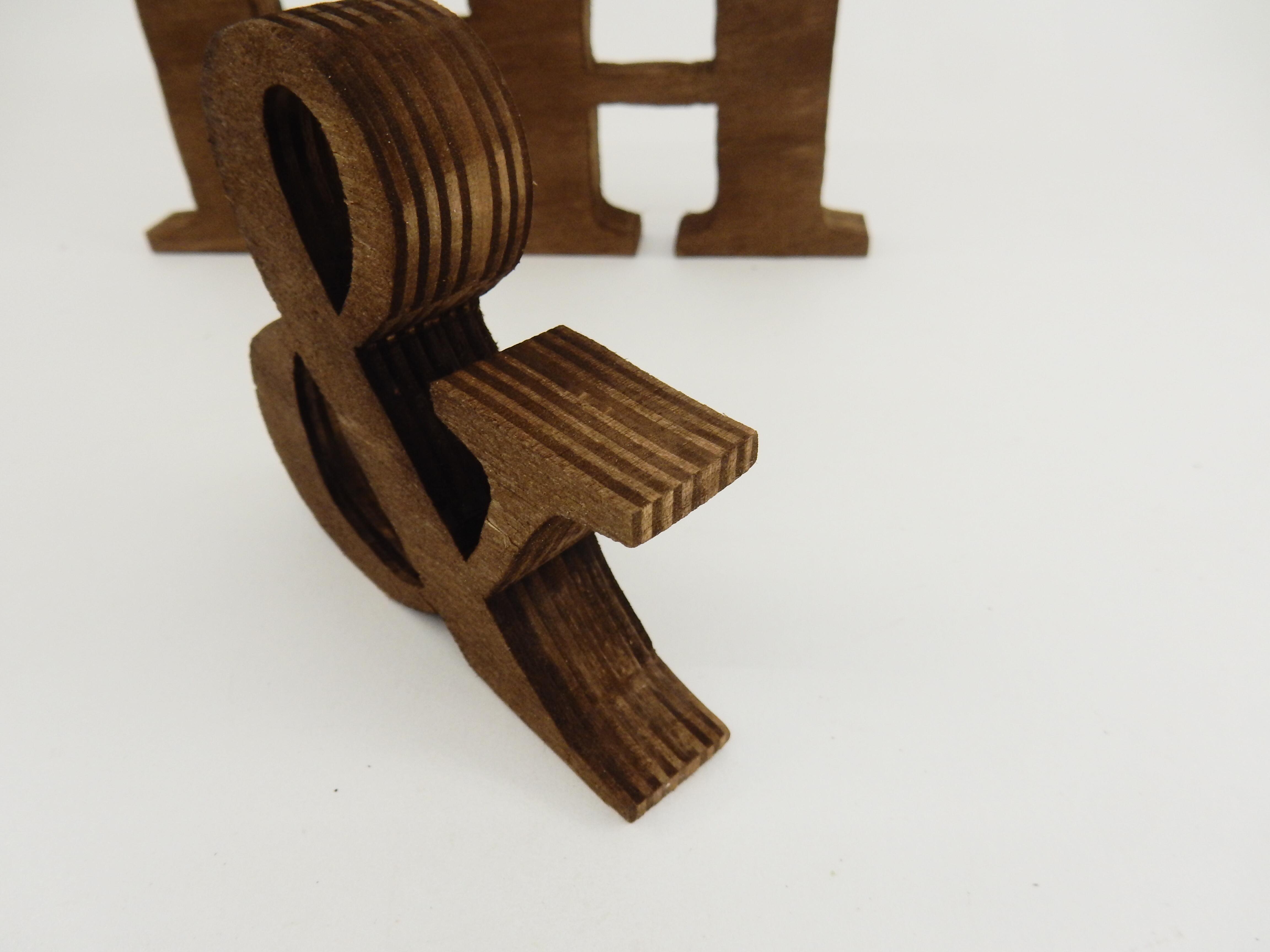 Надпис Г-жа & Г-н ръчно изработен от брезов шперплат. Идеален като семпъл акцент към декорацията на младоженската маса, надписа би могъл да бъде декор към вашата сватбена фотосесия. Декорация, която ще остане скъп спомен и ще краси вашия дом. Материалът е обработен с байц. Размери- дебелина на буквите: 1,8 см; височина- голяма буква: 12.5; малка буква 8 см. Дължина- Г-н: 19.5см; Г-жа : 29 см. Знак & - 8.5 x 8.7 см.